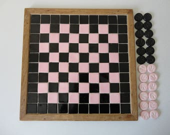 VINTAGE pink and black TILE CHECKERBOARD game with 24 game pieces - sold as found