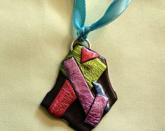 friendly plastic pendant with ribbon abstract