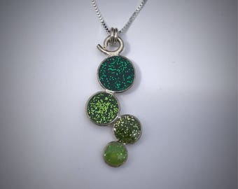 Sterling resin bauble necklace with different shades of green glitter