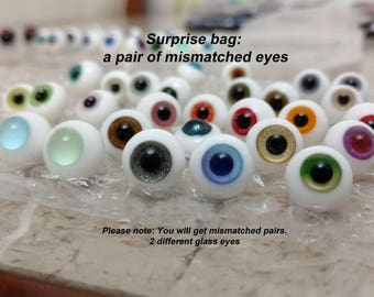 Surprise bag: a pair of mismatched glass eyes