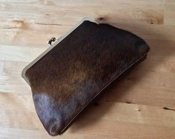 Brown cowhide clutch, antique gold frame, hair on hide bag, fur bag