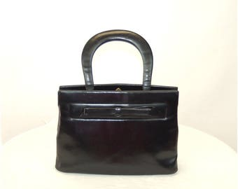 1950s Kelly bag handbag black leather purse red interior leather handle purse with bow