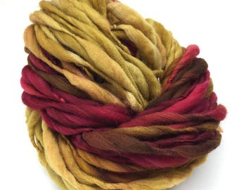 Handspun yarn, 55 yards, thick and thin in self striping red and gold merino wool - 3.45 ounces/ 98 grams