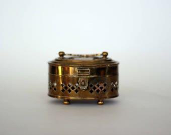 vintage pierced brass oval box with hinged lid
