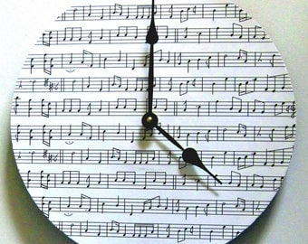 Wall clock. Music clock. Vinyl clock. Clock with sheet music. Piano clock.
