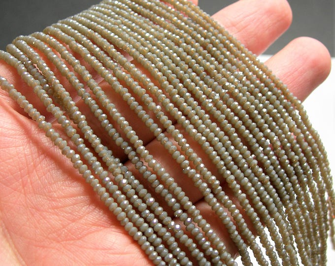 Crystal - rondelle  faceted 1mm x  2mm beads - 193 beads - translucent brown - full strand - VSC30
