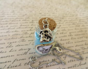 Apothecary Jar Of Blue Skull Dust With Skull Charm Necklace
