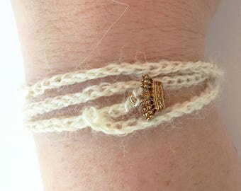 Winter White Crochet Wrap Bracelet with Brass Crown Charm - Honey, You Should See Me in a Crown Wrap Bracelet // Jim Moriarty Jewelry