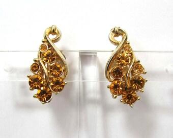 """Amber Rhinestone Clip Earrings  - swirling gold tone setting - 1-1/8"""" x 1/2"""" -1960s"""