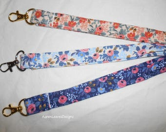 Small Flower lanyards plus charms, in three colors. Floral lanyards. Pink, blue and light blue.