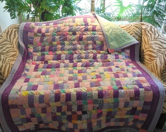 Throw quilt in strips and squares