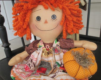 Pumpkin Raggedy Ann with her mini pumpkin