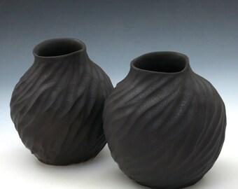 Carved porcelain vase in dark chocolate brown glaze