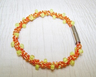 Orange and yellow Kumihimo sead bead bracelet with magnetic clasp