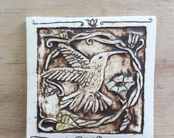 Handmade ceramic hummingbird tile