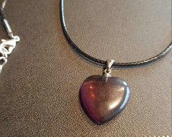Heart pendant on black cord necklace