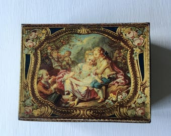 Vintage biscuit tin featuring V & A pastoral  scenes taken from a 17th century snuff box