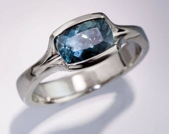 Cushion Fair Trade Teal Blue Sapphire Engagement Ring, Fold Half Bezel Solitaire, in Palladium, Platinum, White Gold, Yellow Gold, Rose Gold