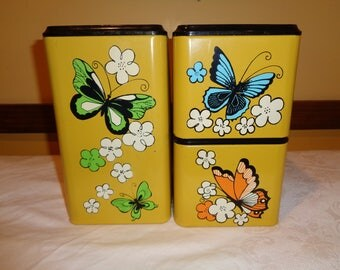 Vintage Canister Set, Mustard colored metal tins with delightful butterfly transfer decal prints and plastic lid covers in Good Condition