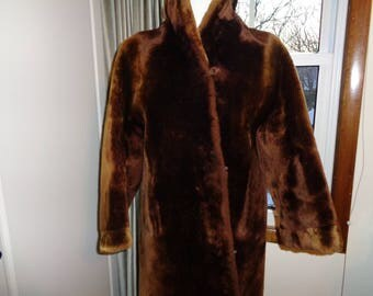 Vintage Chocolate Brown Mouton Fur Swing Style Coat in Vintage Condition with brown silk satin lining that can be worn in inside out as well