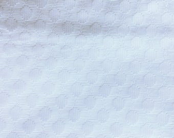 Heavy vintage White cotton embossed fabric.