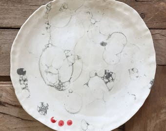 Bubble glaze plate with red accent