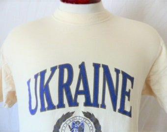 vintage 90s Kiev Ukraine cream natural white graphic t-shirt tourist travel souvenir navy blue metallic gold crest seal logo print Large med