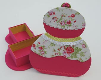 Kit nun in cardboard box with fabric flower and pink fabric
