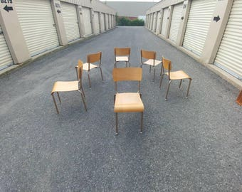 Vintage industrial stacking chairs