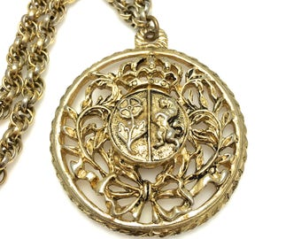 Coro Round Crest Pendant Necklace - Vintage - Gold Tone - Flower and Lion Shield with Vines Crown and Bow # 4235
