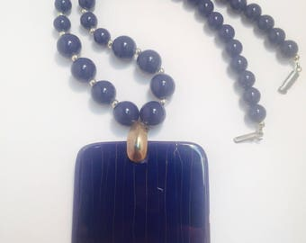 Huge blue and gold pendant necklace