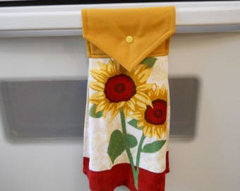 SUNFLOWERS, Hanging kitchen towel with colorful sunflowers.