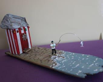 fishing man & beach hut