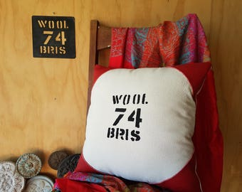 WOOL brand cushion handmade using vintage stencil on calico cotton with leather corners and cotton ticking back.