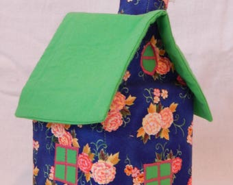 Blue House with handkerchiefs with flowers and green roof