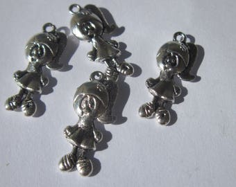 4 doll 18mm silver plated charms (1979).