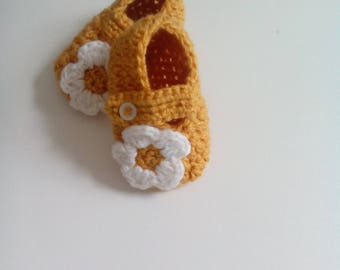 a pair of crocheted baby booties by hand