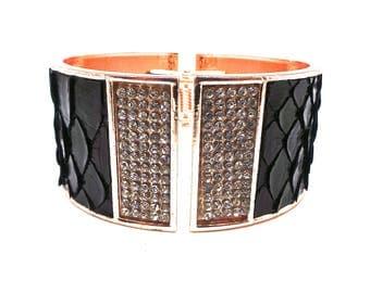 Rhinestones and snake leather bracelet