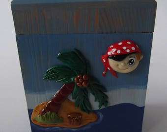 Wooden piggy bank and cold porcelain for little pirate