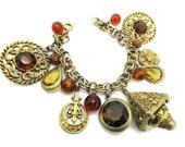 RESERVED Florenza Fleur de Lis Bracelet/ Goldette Fancy Bezel set Glass Charm/ Huge Etruscan Fob Charm /Chunky Amber Glass Charm Bracelet