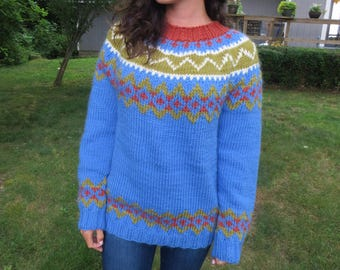 Woman's hand knit bulky weight blue wool fair isle sweater