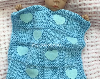 Knitted blanket with hearts