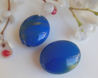 set of 2 oval shaped plastic beads