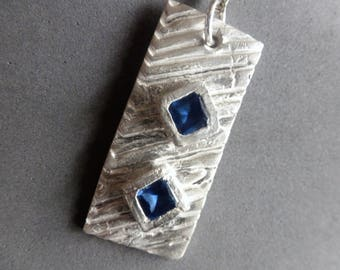 Sapphire Diamonds Silver Pendant is a heavily textured fine silver rectangle embedded with two bezeled Sapphire diamonds on bar/link chain.