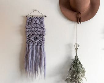 Purple/gray woven wall hanging