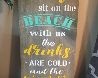 Come sit on the beach with us the drinks are cold and the friendship is free