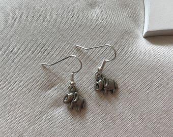 Tiny elephant silver coloured earrings end of line