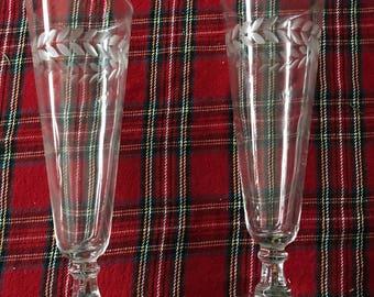 Vintage set of two Pilsner glasses with etched leaf/stem design around top.