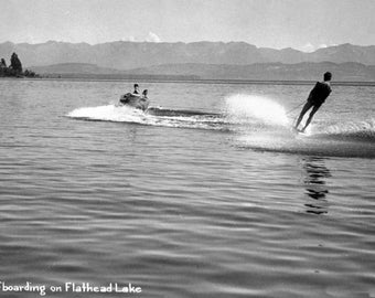 Flathead Lake, Montana - Man Water-Skiing; Couple in Speedboat - Vintage Photograph (Art Print - Multiple Sizes Available)