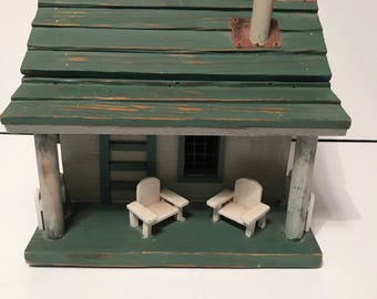 Super cute vintage birdhouse with Adirondack chairs and porch